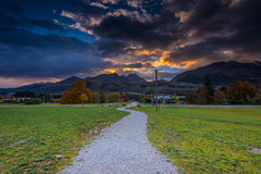 Pathway to sunrise behind the mountains Royalty Free Stock Photo