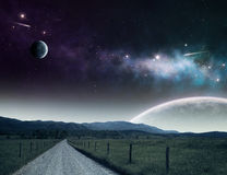 Pathway to universe. Pathway leading up to the night sky with moons and galaxies Stock Photography