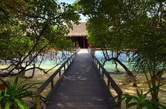 Pathway to water bungalow. Travel background Stock Photo