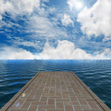 Pathway on the water to a nice sky background Stock Photo