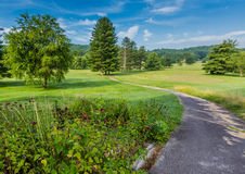 Pathway winds through summer park in North Carolina. A former golf course Royalty Free Stock Photos