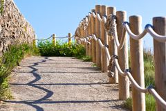 Pathway with wood post fence Stock Photo