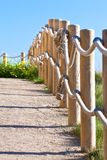 Pathway with wood post fence. Pathway with wood post and thick rope fence. Taken at Saint-Mathieu, Brittany, France Royalty Free Stock Images