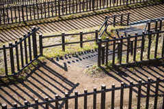 Pathway with wooden fence in park Stock Images