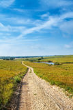 Pathways through the Flint Hills. A gravel road going through a grass prairie in the flint hills of Kansas Royalty Free Stock Photo