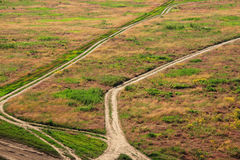 Pathways in open field Royalty Free Stock Images