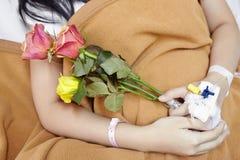 Patiënt en bloem Royalty-vrije Stock Foto's