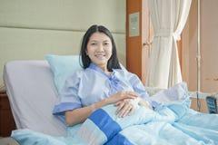 Patiënten aan slaap het glimlachen Stock Foto