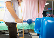 Patian on crutches. In hospital on blur background Stock Images