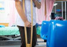 Patian on crutches. In hospital on blur background Stock Photos