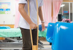 Patian on crutches. In hospital on blur background Stock Photography