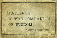 Patience is Saint Augustine. Patience is the companion of wisdom - quote of ancient Christian theologian and philosopher Saint Augustine printed on grunge Royalty Free Stock Image