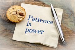Patience is power - text on napkin. Patience is power - inspiraitonal handwriting on a napkin with a cookie Royalty Free Stock Photo
