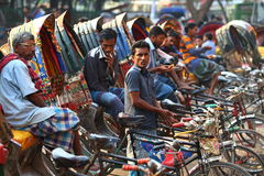 Patience. Riksjah drivers waiting patiently for customers in Dhaka Bangladesh Royalty Free Stock Photo
