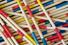 Patience is a virtue. A child's pick up sticks game in macro stock images