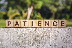 Free Patience Word On Wooden Block Stock Image - 171114861