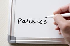 Patience written on whiteboard Stock Images