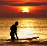Patiens - solnedgångsurfare Royaltyfria Bilder