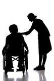 Patient. Silhouette of a nurse putting hand on patient's shoulder Stock Photo