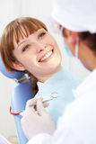 Patient. Image of smiling patient looking at the dentist with mirror Stock Photos