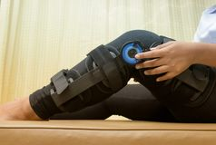 Patient adjustable angle on knee brace ,Knee support. For leg or knee injury stock image
