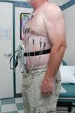 Patient angebracht zu 12 Blei EKG Lizenzfreie Stockfotografie