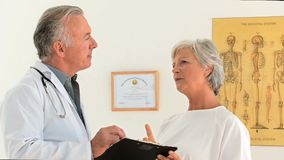 A patient answering her doctor about a few questions Stock Photos
