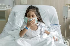 Patient asian kid coughing with mask on hospital. Bed with doctor clinic stock images