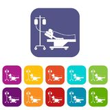 Patient in bed on a drip icons set Stock Photo