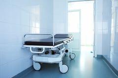 Patient bed in hallway. Patient bed in hospital hallway stock image