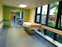 Patient beds lined up in corridor in a local hospital , London,uk stock photos