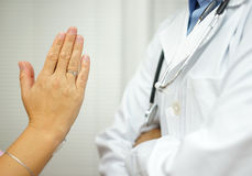 Patient  is begging doctor for medical support,doctor is refus Royalty Free Stock Photography