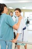 Patient Being Assisted By Physical Therapist Royalty Free Stock Photography