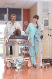 Patient being rushed to hospital Stock Photos