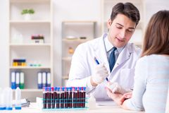 The patient during blood test sampling procedure taken for analysis. Patient during blood test sampling procedure taken for analysis stock images