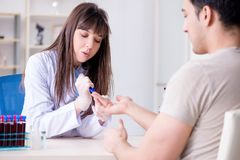 The patient during blood test sampling procedure taken for analysis. Patient during blood test sampling procedure taken for analysis stock image