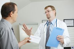 Patient bribing doctor Royalty Free Stock Images