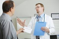 Patient bribing doctor Stock Photos