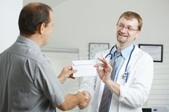 Patient bribing doctor Stock Image