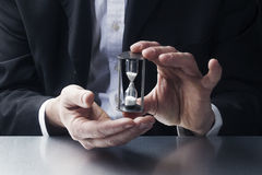 Patient businessman with egg timer in hands at work Royalty Free Stock Images