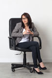 Patient businesswoman posing in office chair for her start-up job Royalty Free Stock Photo