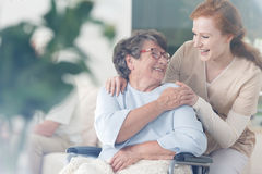 Patient and caregiver spend time together. Happy patient is holding caregiver for a hand while spending time together Royalty Free Stock Image