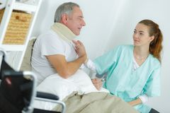 Patient with cervical collar in clinic. Patient with a cervical collar in clinic stock photo