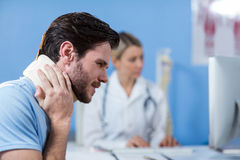 Patient with a cervical collar. In clinic royalty free stock image