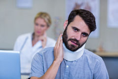 Patient with a cervical collar Stock Image
