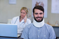 Patient with a cervical collar. Portrait of patient with a cervical collar in clinic royalty free stock images