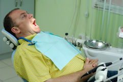 Patient in chair of dentist Stock Image