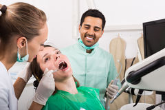 Patient checking out her teeth at dentist Stock Photography