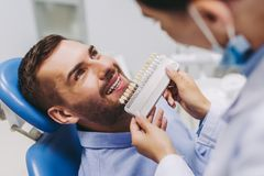 Patient choosing tooth implants stock photo