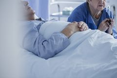 Patient in a coma and wife Stock Photography